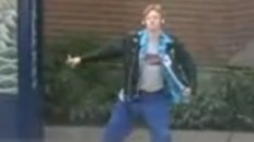Guy Dancing Like Michael Jackson at a Bus Stop