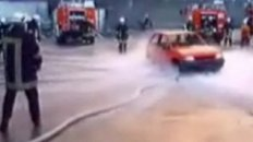 Firemen Lift Car With Hose Water