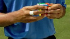 Tiger Woods Solves a Rubik's Cube